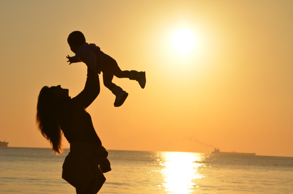 https://www.canva.com/photos/misc/MADGyBenrmM-woman-carrying-baby-at-beach-during-sunset/?query=mothers#